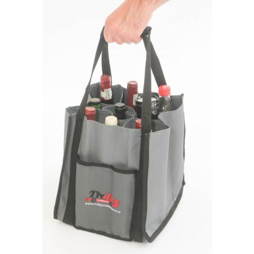A hand lifts a Bottle Bag